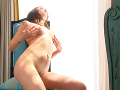 Busty brunette Kat Dior is poking her tight pussy