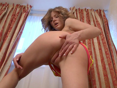 Curly brunette Patritcy is penetrating her vagina
