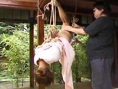 Hanged beauty is demonstrating her body