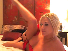 Slender blonde is penetrating her pussy with dildo