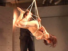 Asian with red hairs being tied and hanged