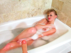 Blonde is sucking her lovely sexy toy