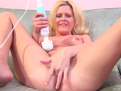 Sexy blonde Kelly Surfer is fucking in her alluring tasty snatch