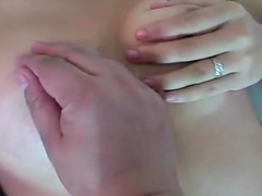 Cute Asian babe is lying and masturbating her pussy