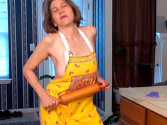 Mature milf Bobby Bentley pokes her snatch with a wooden stick