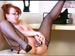 Sexy milf redhead in office