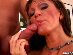 Nasty brunette with cute face is getting fucked in her mouth