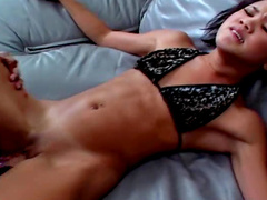 Nice looking brunette is fucking with strapon