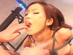 Sexy tied Asian cutie is licking balls