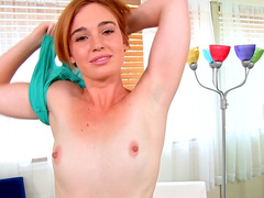 Jodi Taylor is poking her nice shaved puss with her hand