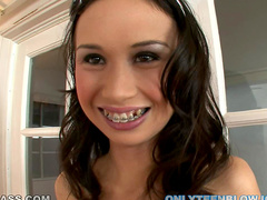 Braces girl sucks off a dick