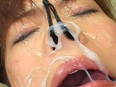 Cute Asian babe with gag in mouth gets sperm