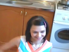 Russian brunette girl gets naked at the kitchen's floor