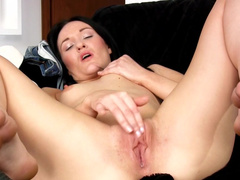 Horny brunette milf gets naked and masturbates