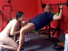 Sweet brunette is sucking an old dick