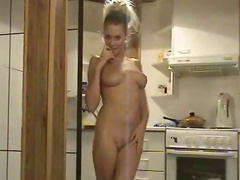 Busty chick with a nice ass takes her clothes off
