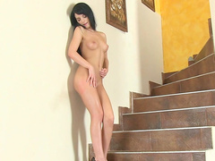 Jessica Swan is lying on the stairs naked