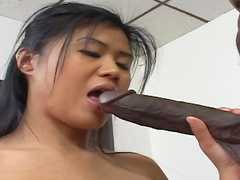 Asian schoolgirl sits on monster black cock