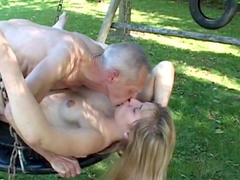 Old man fucks sexy young girl on the green grass