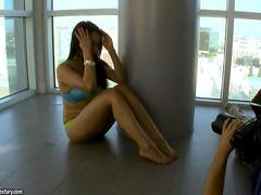 Flexible Asian bends body like a pretzel