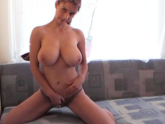 Kathy shows off her big natural boobs