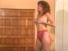 Curly-haired mommy poses in her red panties