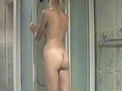 Blonde girl with hot tits caught naked in the shower
