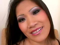 Asian slides glass toy into her slit