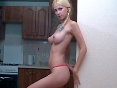 Blonde Erica poses with naked boobies