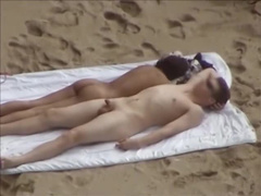 Voyeur beach sex on towel