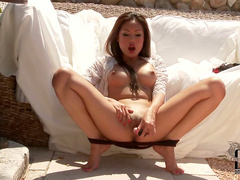 Erotic solo Asian toy tease outdoors