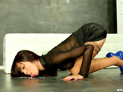 Clothed Asian model is getting tone of cum