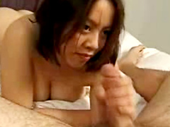 Asian gives fat guy a footjob