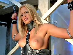 Chained and collared girl masturbates