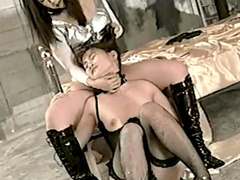 Hot Asian couple are fucking each other pusses with dildos