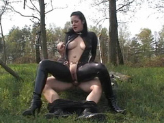 Leather catsuit sex in woods