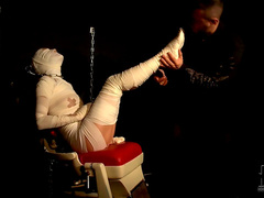 Mummified girl in his dungeon