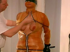 Chubby girl wrapped in latex and rope