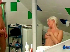 Gorgeous blonde dame does a blowjob in the bathroom