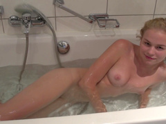 Pretty slick blonde is taking a shower