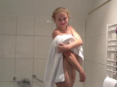 Pretty slick blonde is taking a shower
