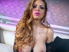Stunning pornstar with fake tits gets naughty on the sofa