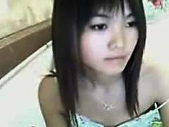 Adorable Asian teen on webcam