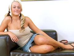 Tattooed blonde Brandy Blair is playing with a big dildo