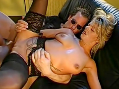 Tina being drilled on the black leather sofa