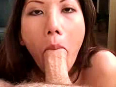 Beautiful cocksucking Asian eats a dick