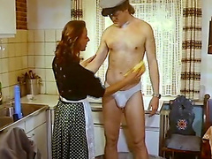 Retro redhead suck dick in the kitchen