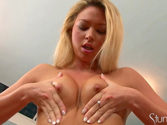 Blonde Natalia Forrest is poking her pussy