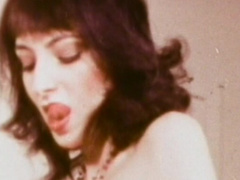 Dark-haired lady is sucking a dick