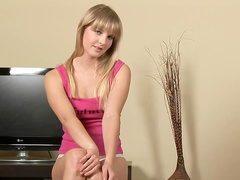 Young girl Rosea has a shaved pussy and a vibrator